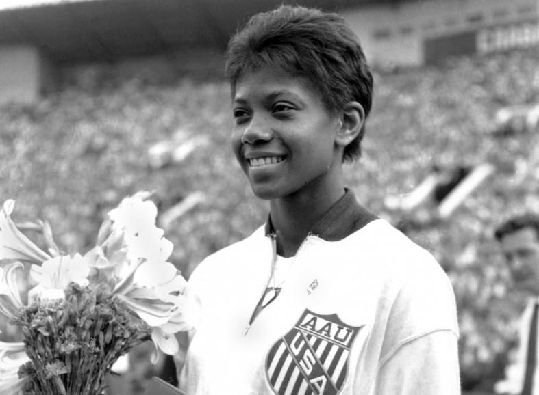 Wilma-Rudolph-of-Clarksville-Tennessee-holds-flowers-and-medals-presented-to-her-after-two-victories-in-the-U.S.-Russia-track-and-field-meet-in-Moscow-Russia-on-July-15-1961.-Rudolph-equal